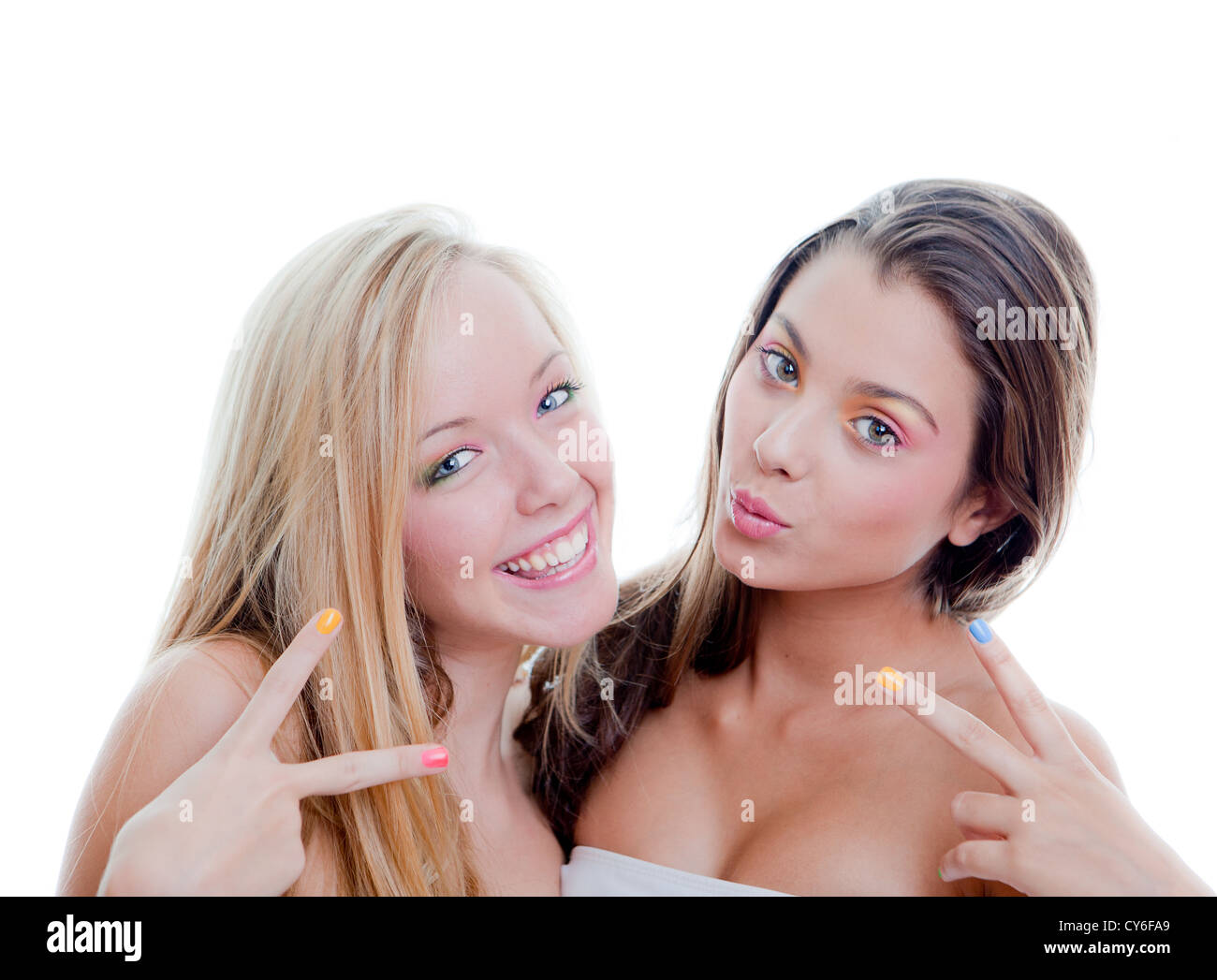 young fashion teens doing v sign - Stock Image