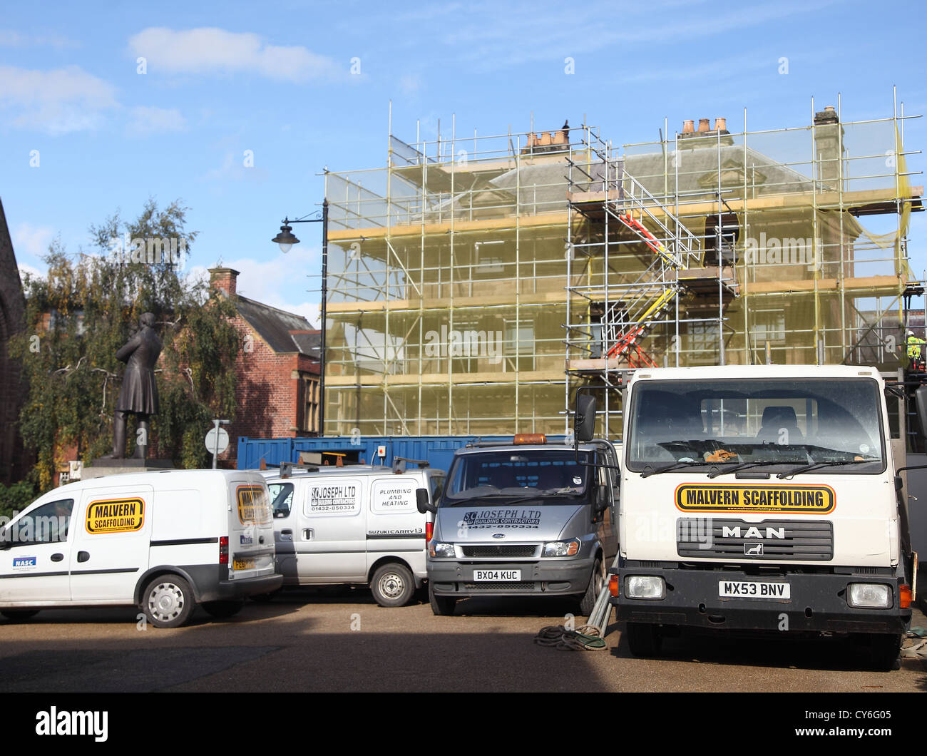 Scaffolder's trucks in font of a building renovation project in Hereford, England, UK. October 2012 - Stock Image