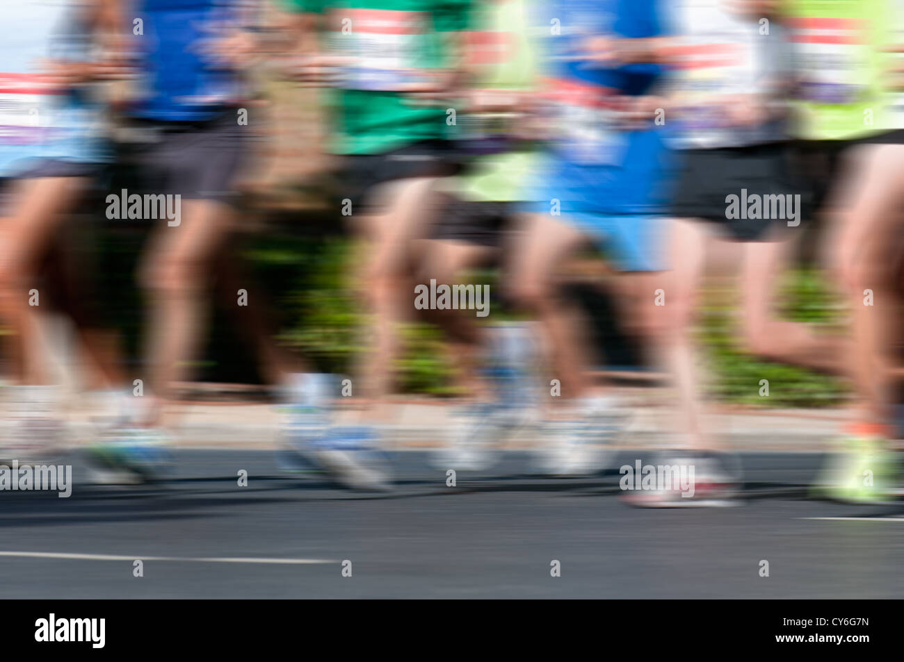 Group of marathon racers running with heavy motion blur applied - Stock Image