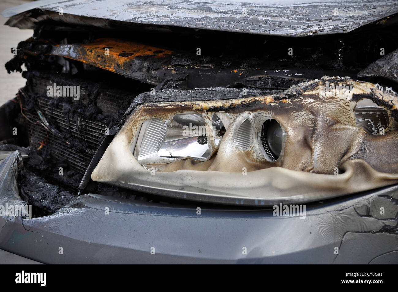 Close up detail of a burnt car in a car accident - Stock Image