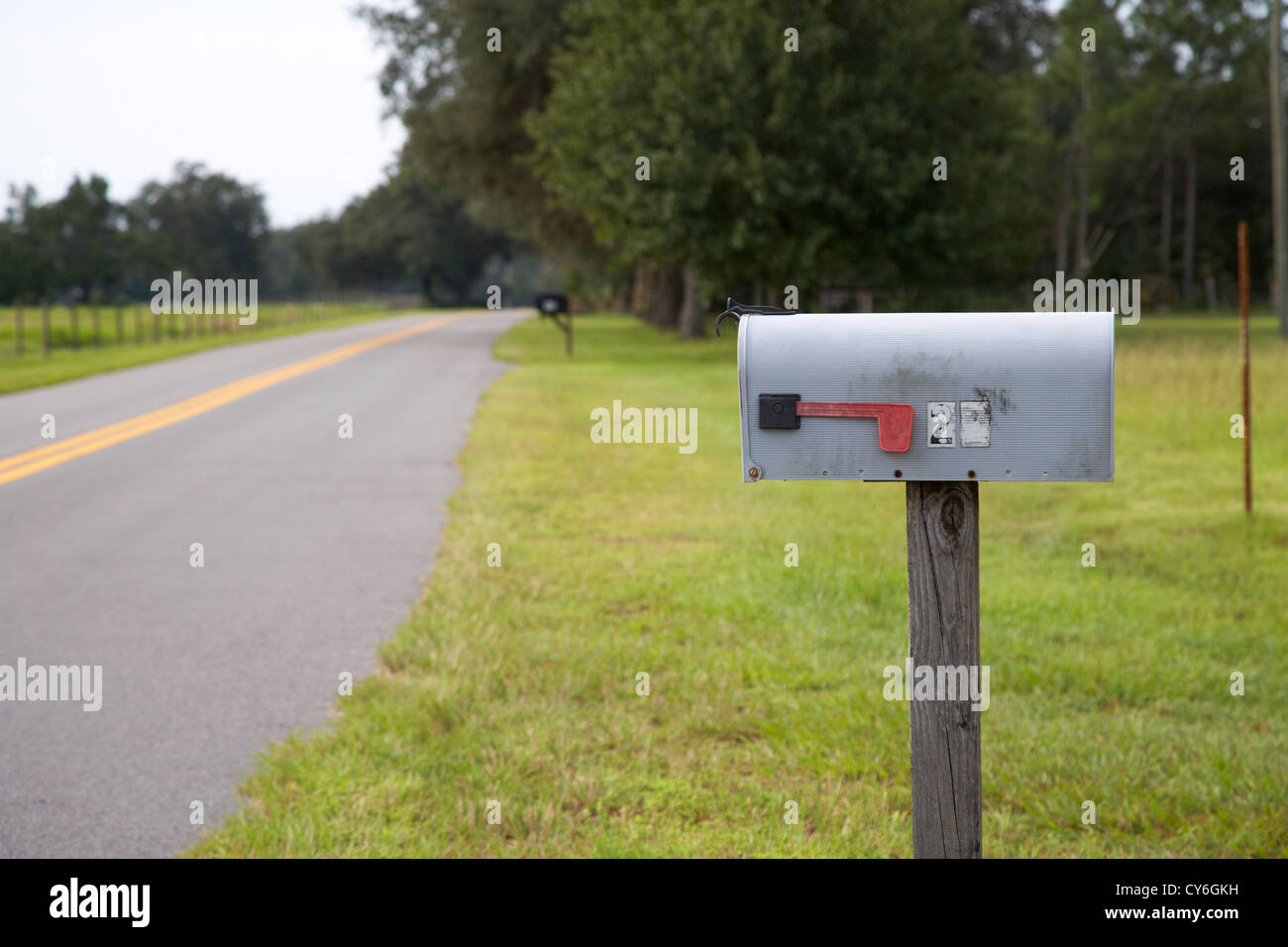 mailboxes on a small rural road florida usa - Stock Image