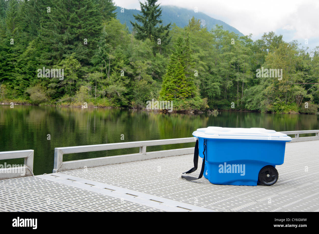 Cooler on a dock by a lake - Stock Image