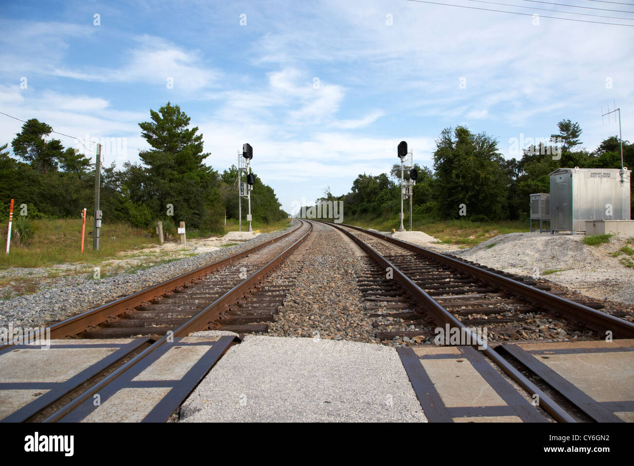railroad crossing dual train tracks railroad florida usa - Stock Image