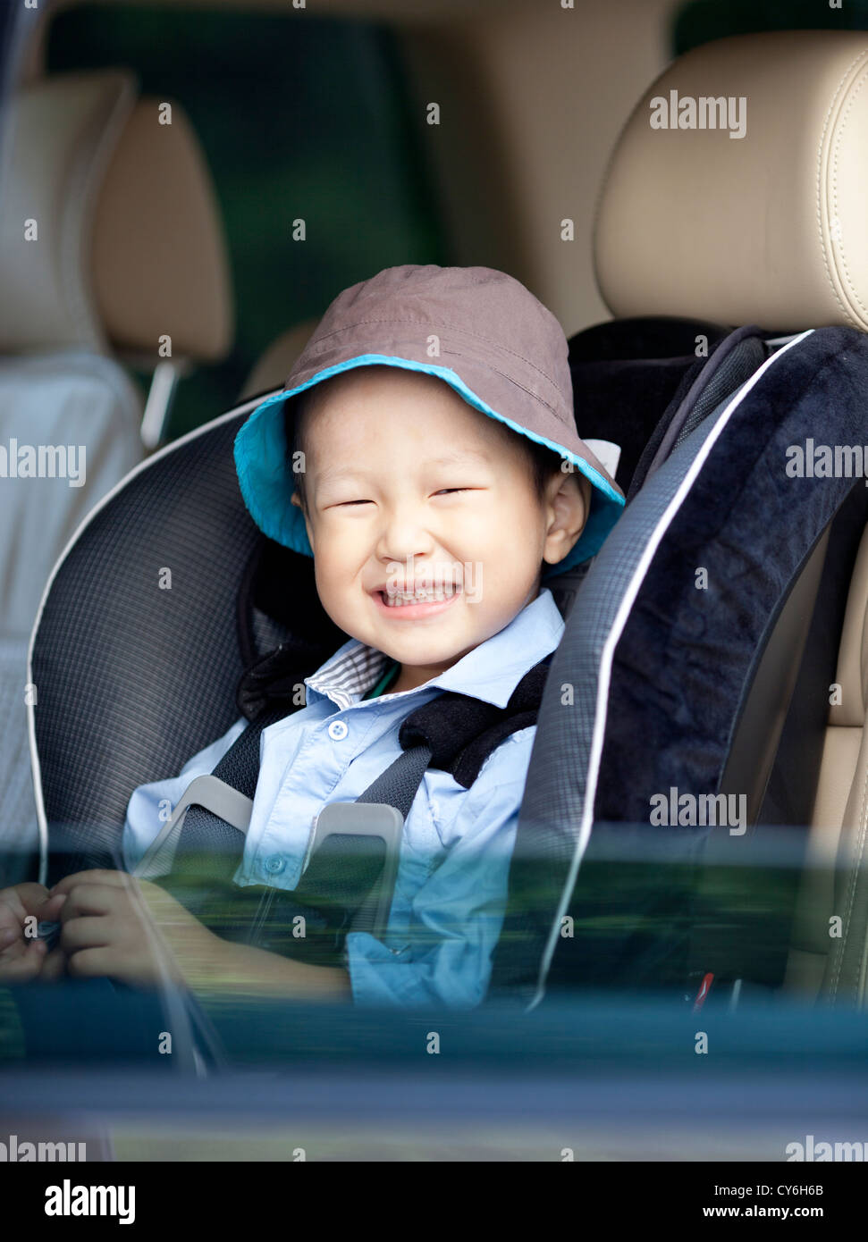 Portrait of a little smiling asian boy in the car Stock Photo