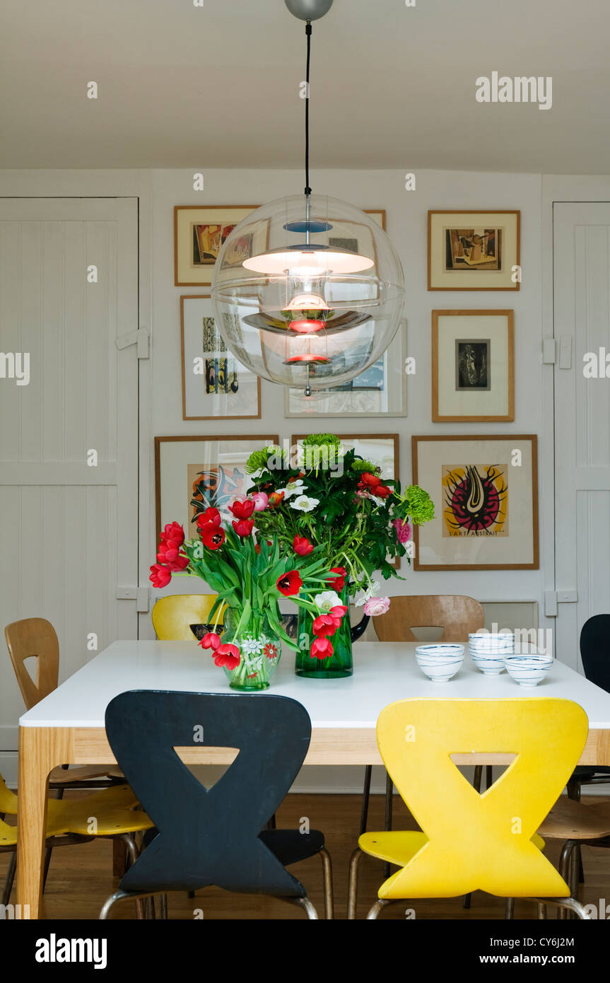 Picture of: Dining Room Table With Tulips And Original Pendant Globe Light C1970 Stock Photo Alamy