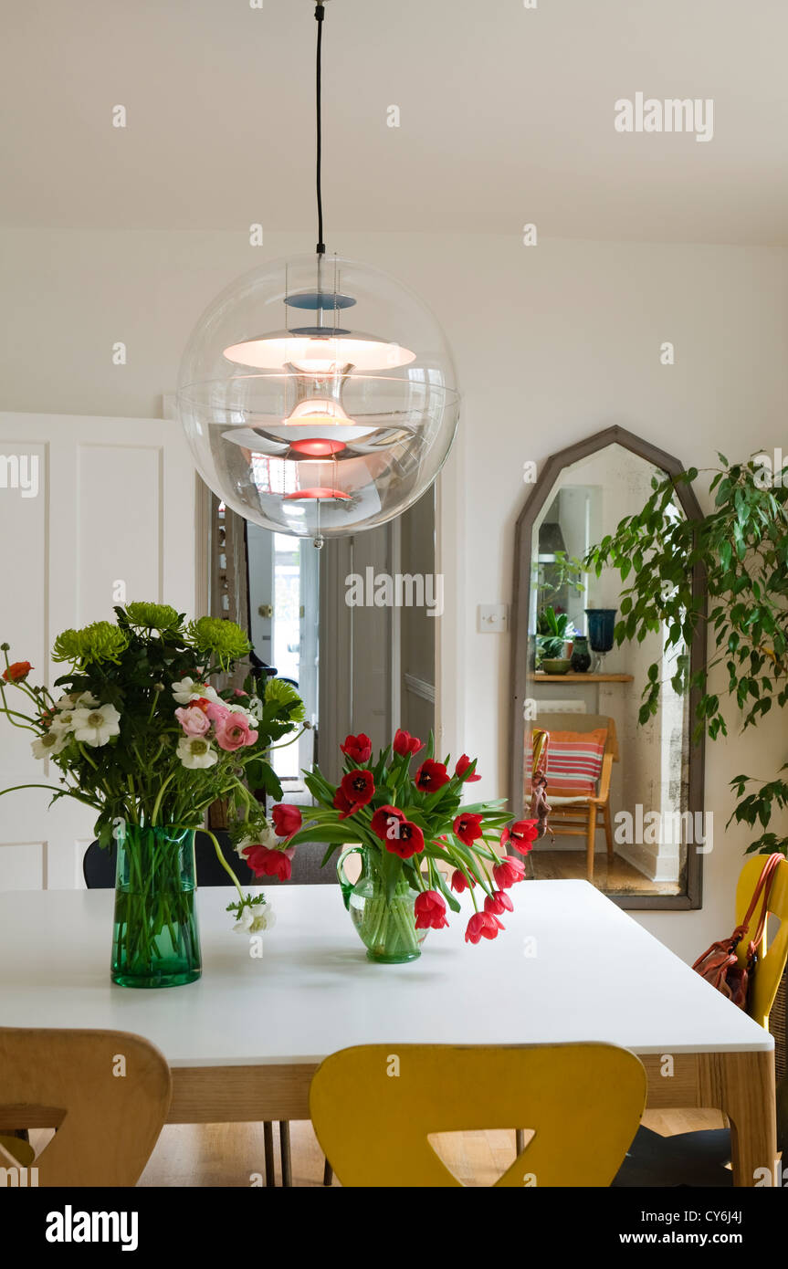 Dining Room Table With Tulips And Original Pendant Globe Light C1970 Stock Photo Alamy
