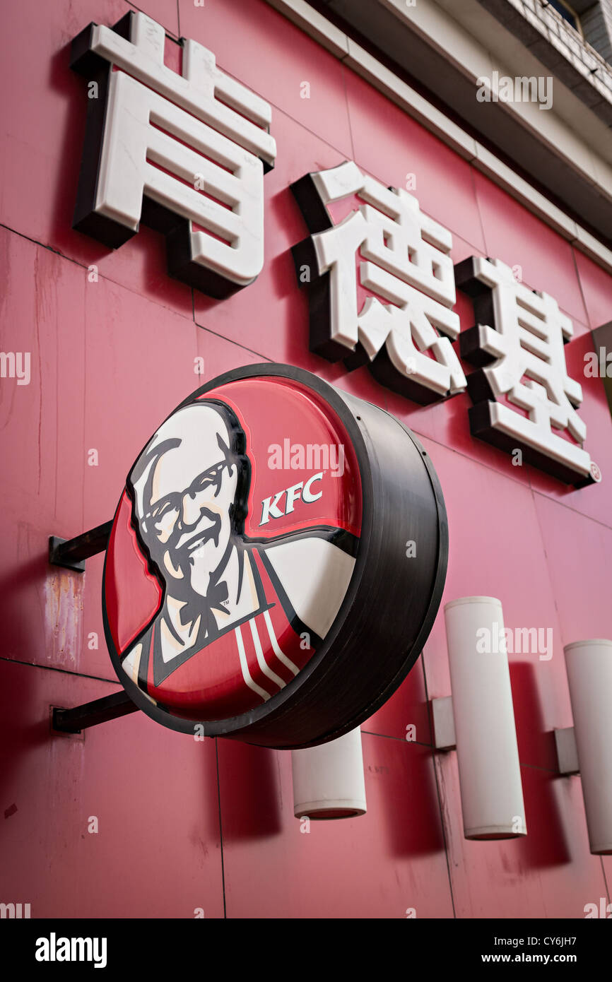 Kentucky Fried Chicken fast food restaurant sign in Chinese characters in Beijing, China - Stock Image