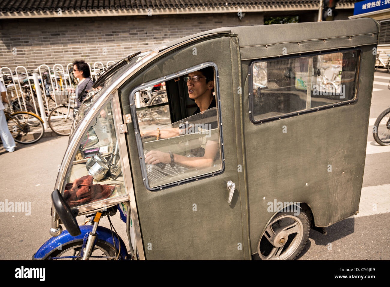 An enclosed scooter during summer in Beijing, China - Stock Image