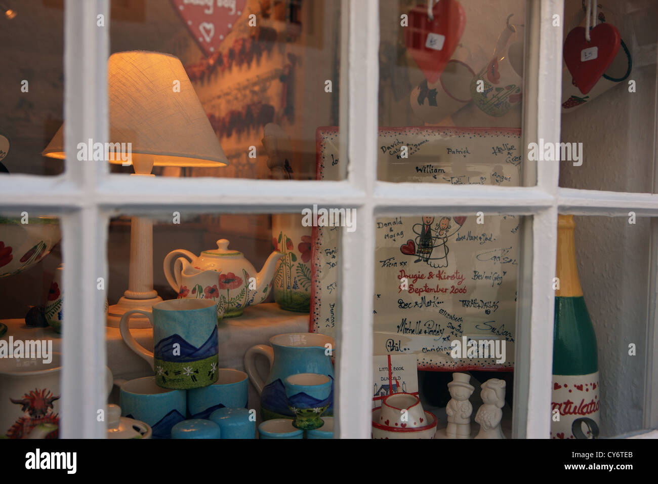 Shop window selling tourist gifts and nik naks in the Perthshire town of Dunkeld - Stock Image