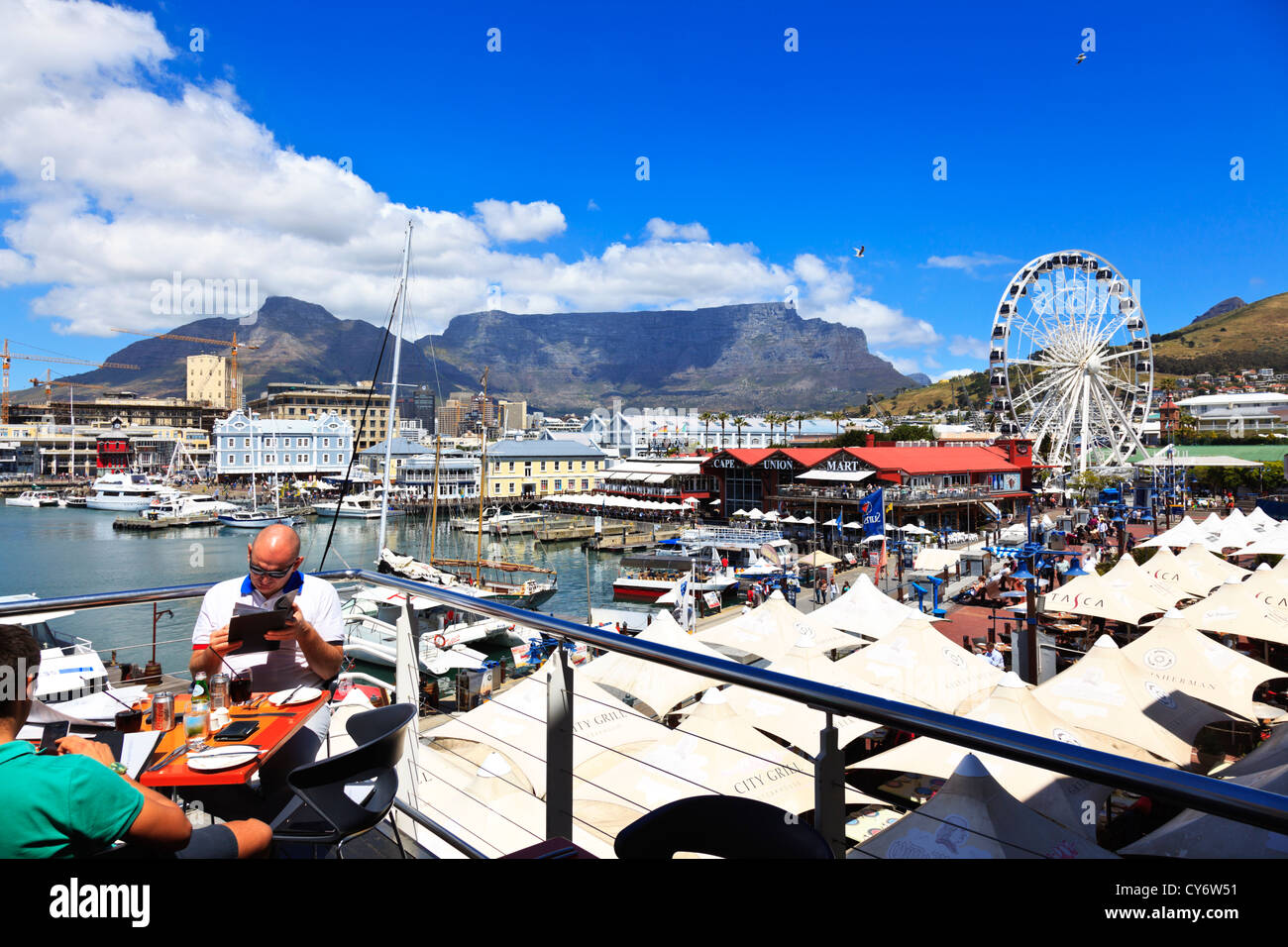Diners having lunch at an open air restaurant at the Victoria and Albert waterfront Cape Town South Africa. - Stock Image