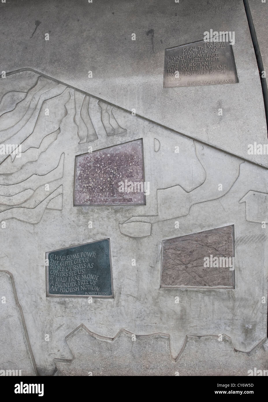 Inscriptions carved in Cannongate street wall of the Scottish Parliament Building in Edinburgh Stock Photo