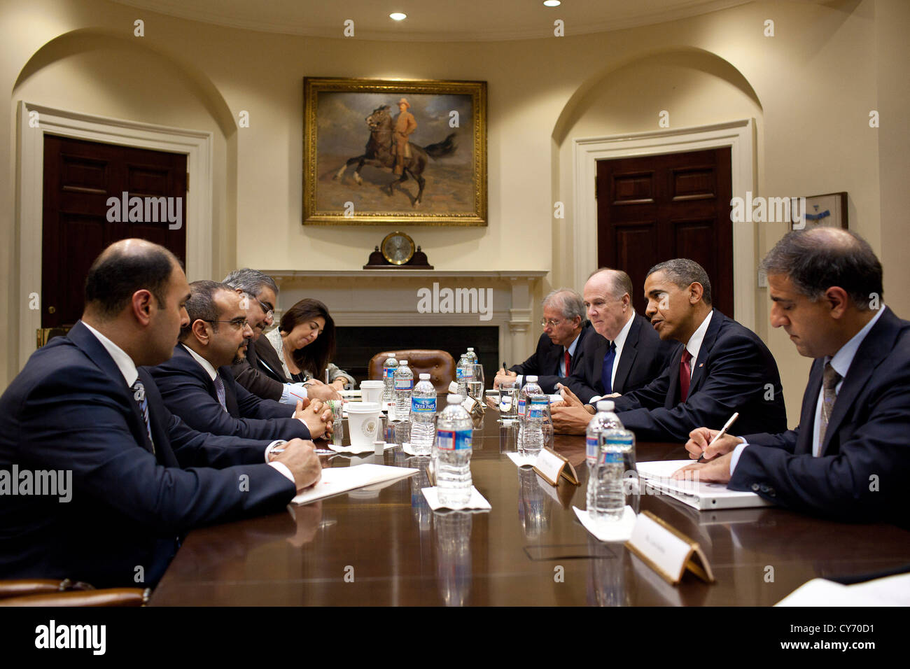 US President Barack Obama drops by a meeting between National Security Advisor Tom Donilon and Crown Prince Salman - Stock Image