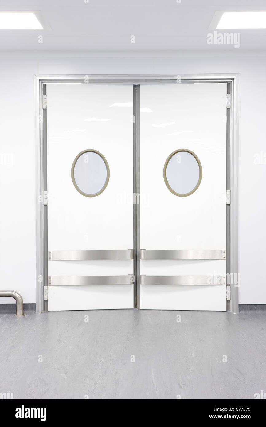 White modern contemporary factory swing doors, clean, crisp - Stock Image