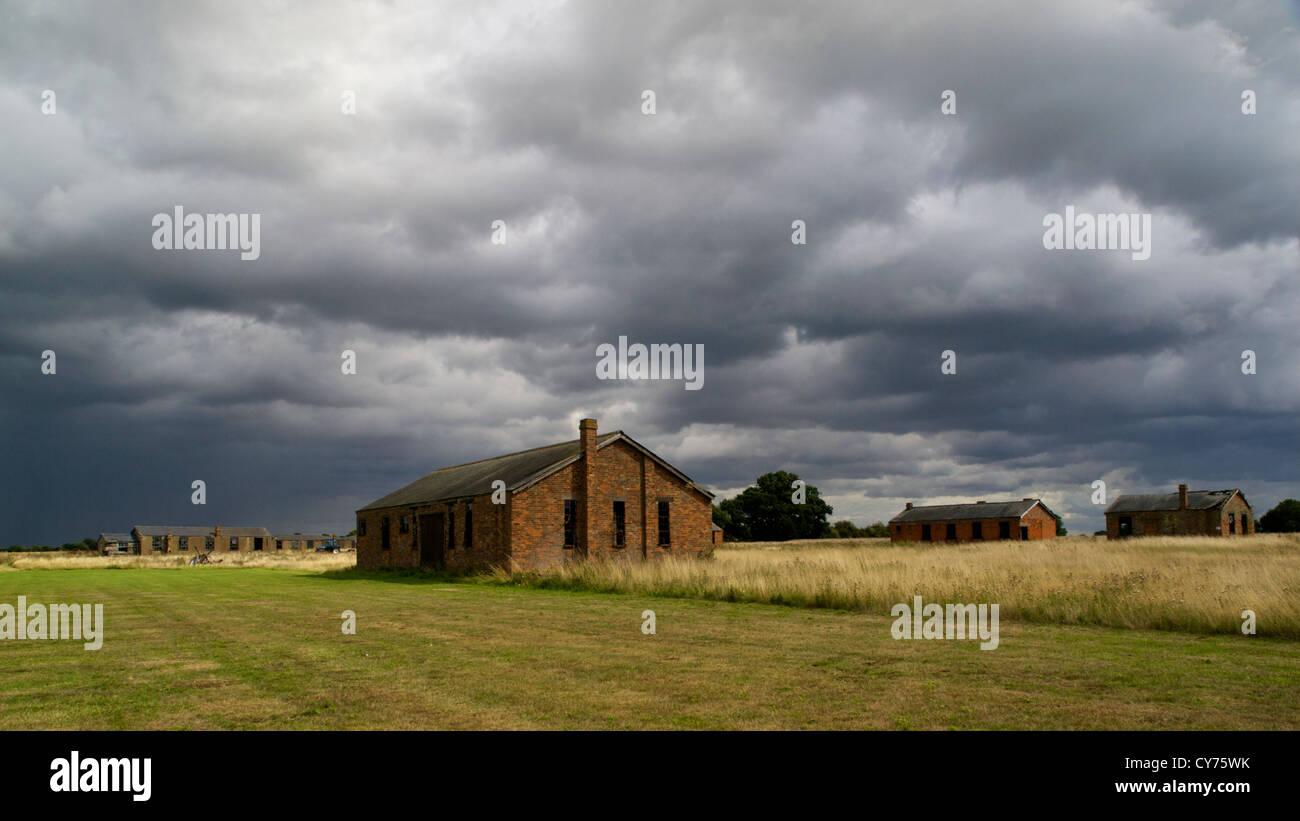 Stow Maries World War 1 Aerodrome under stormy Essex skies, panoramic crop. - Stock Image