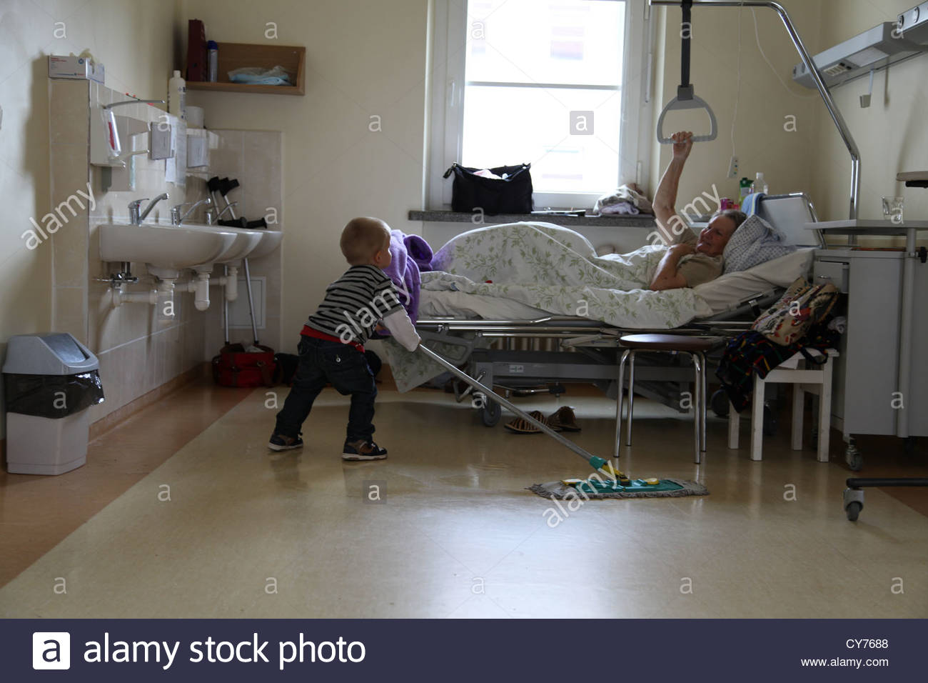 child, great grandmother, kid, nanny, granny, care, hospital, cleaning, clean, - Stock Image