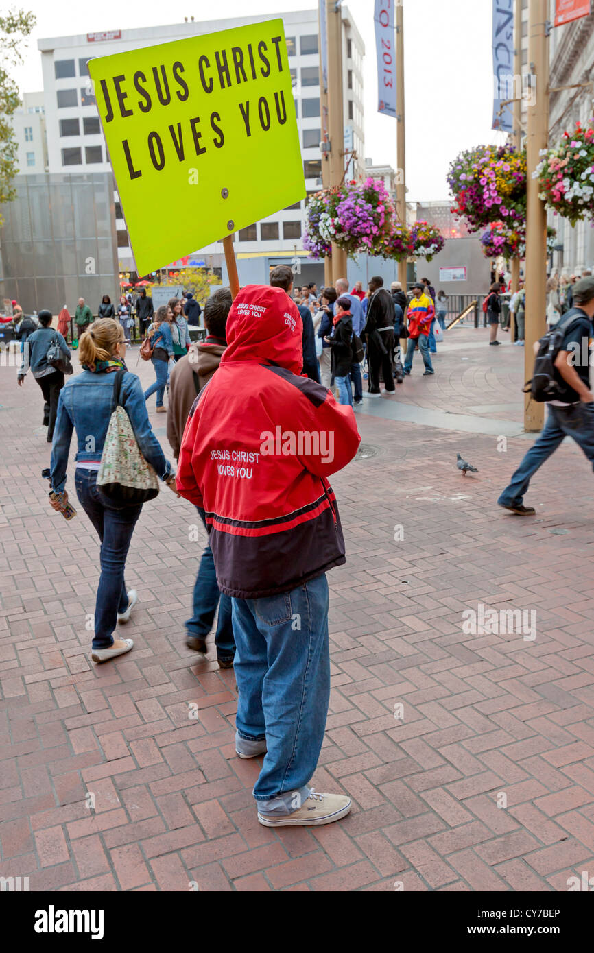 A religious demonstrator on a San Francisco city sidewalk. - Stock Image