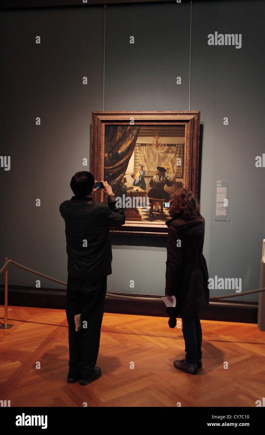 Visitors admiring Vermeer\'s \