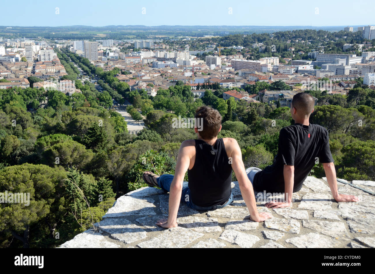 Young Men Admire the View of Nimes from the Roman Tower or Tour Magne Nimes Gard France - Stock Image