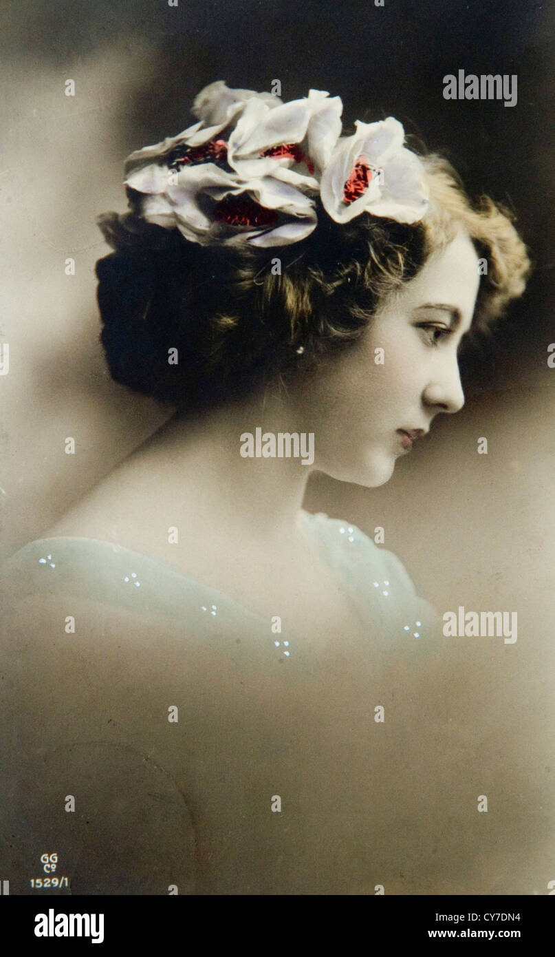 Edwardian pinup model 1900s 1910s. UK. Hand coloured colored photo postcard. - Stock Image