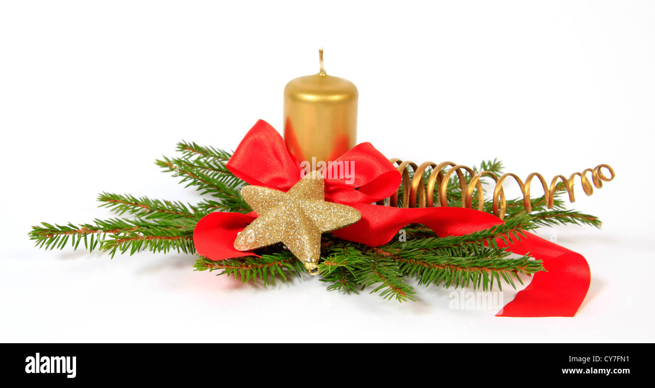 Christmas decoration with the gold star, twigs of the spruce and candle - Stock Image