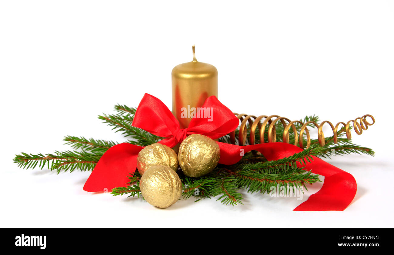 Christmas decoration with the golden nuts, twigs of the spruce and candle - Stock Image
