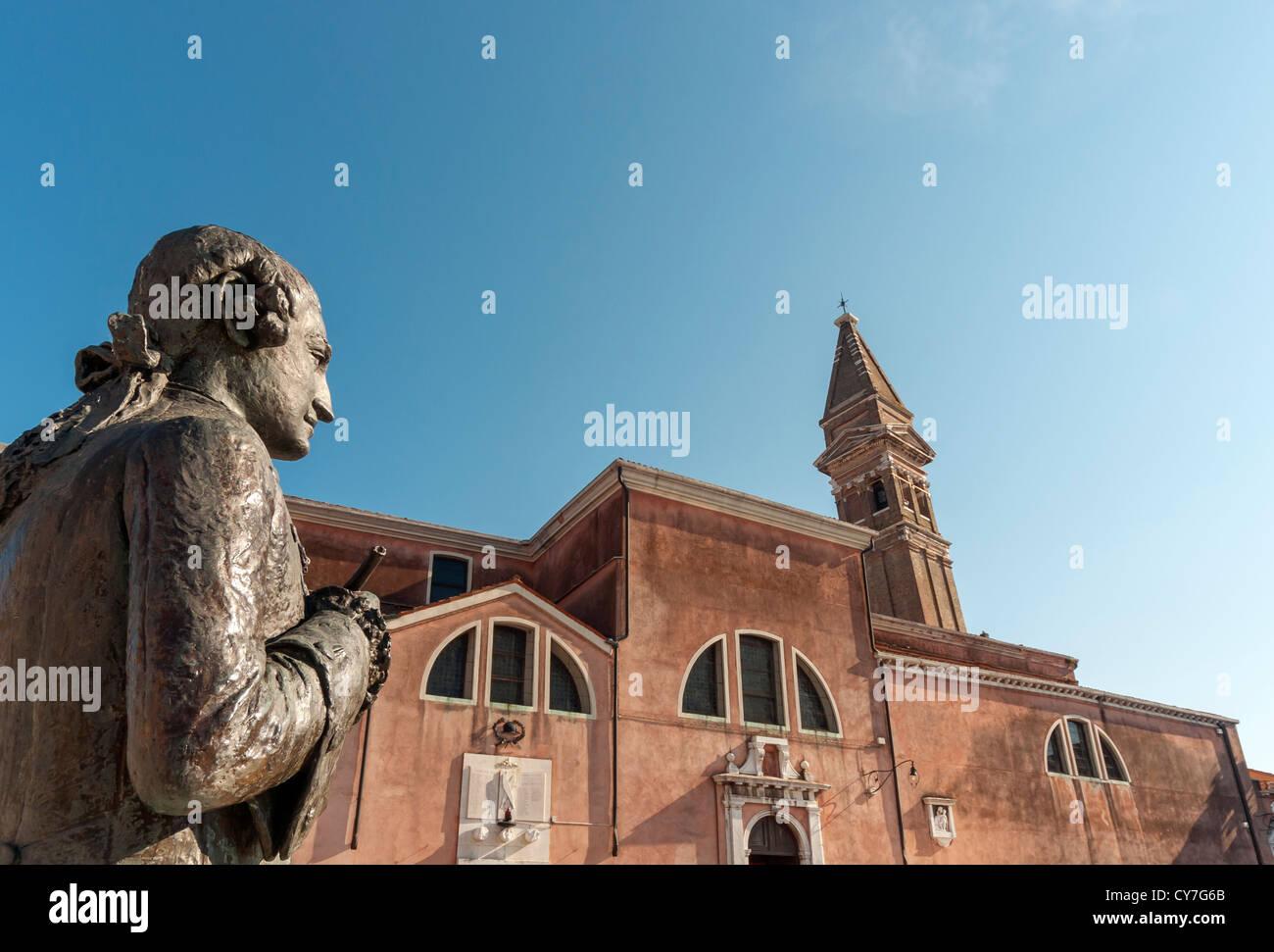 Statue of Baldassare Galuppi in front of San Martino Church, Burano, Venice, Veneto, Italy - Stock Image