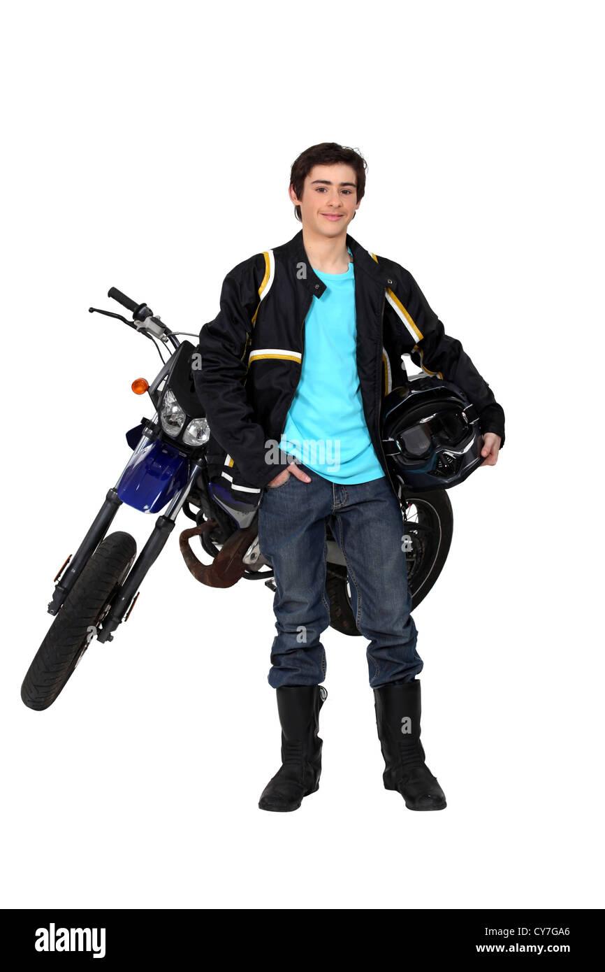 Teenager riding a motorbike - Stock Image