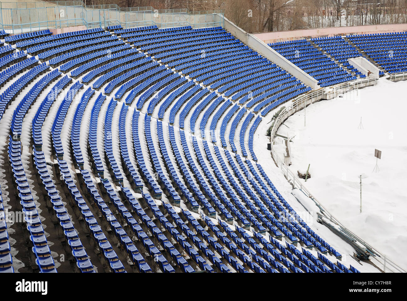 part of a snow-covered stadium, football ground in winter - Stock Image