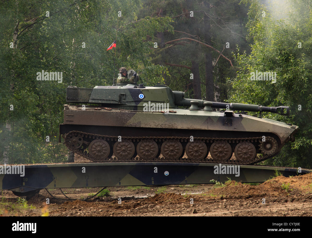 Self-propelled 2S1 howitzer of the Finnish Army crossing a bridge - Stock Image