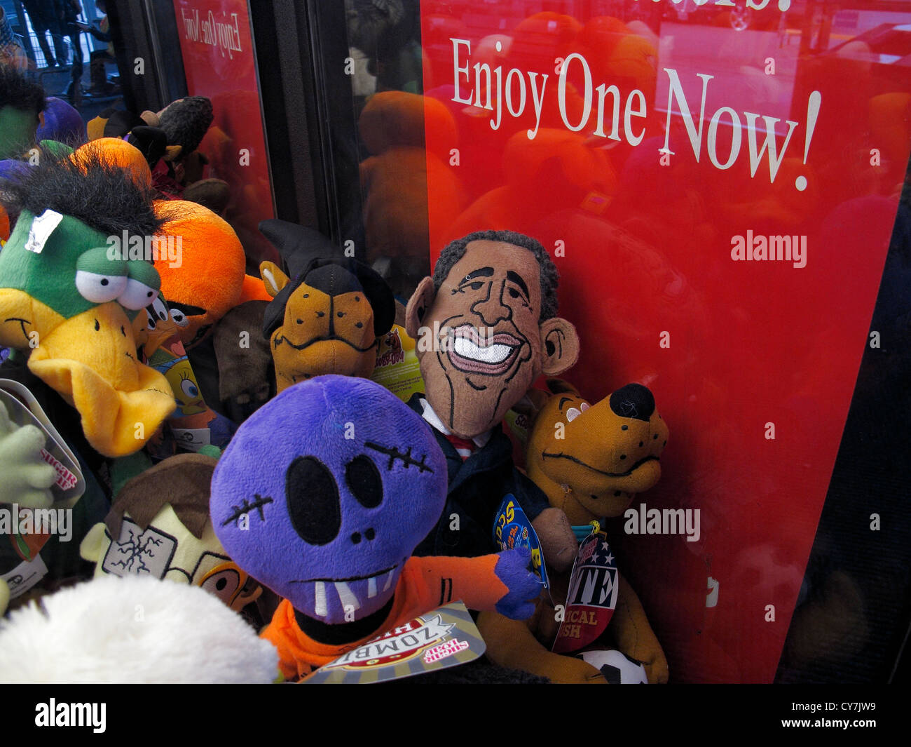 President Obama toy doll in a claw machine crane. - Stock Image
