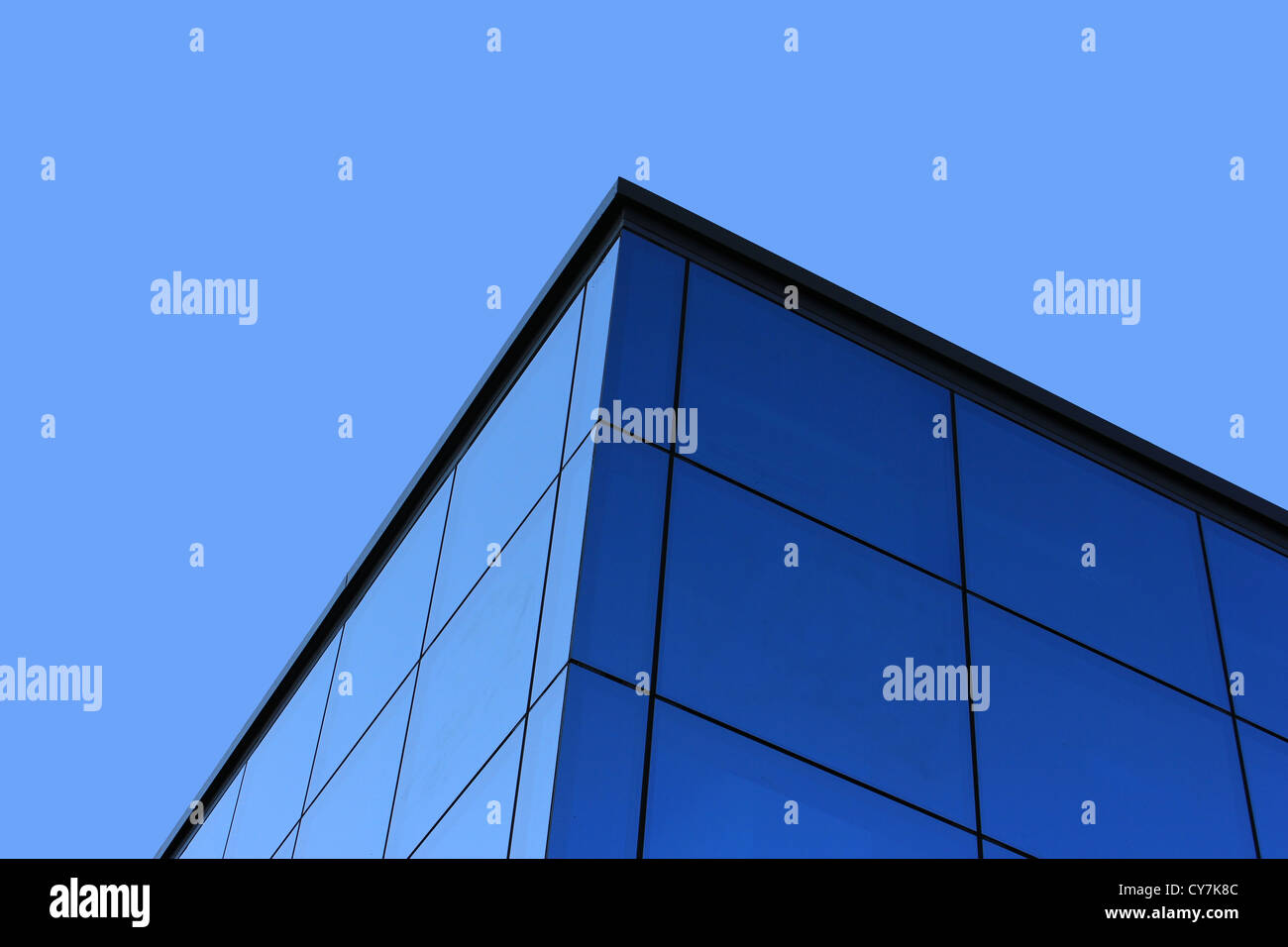 Blue sky and glass construction detail - Stock Image