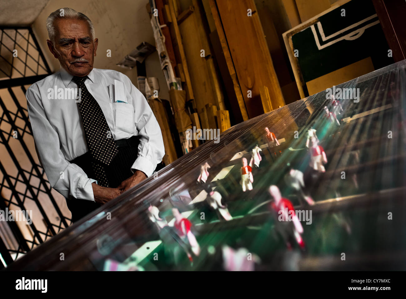 Efraín Cepeda, a table football workshop owner, poses for a picture with the finished table in his workshop, - Stock Image
