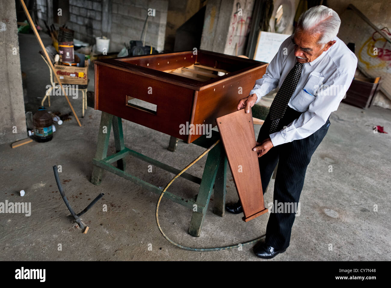 Efraín Cepeda, a table football workshop owner, shows an unfinished table in his workshop, Quito, Ecuador. - Stock Image