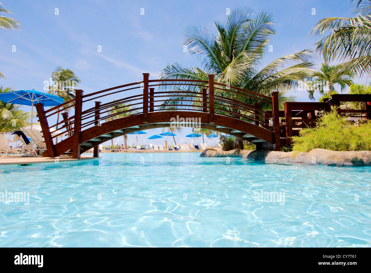 Tropical wooden bridge over the swimming pool Stock Photo ...