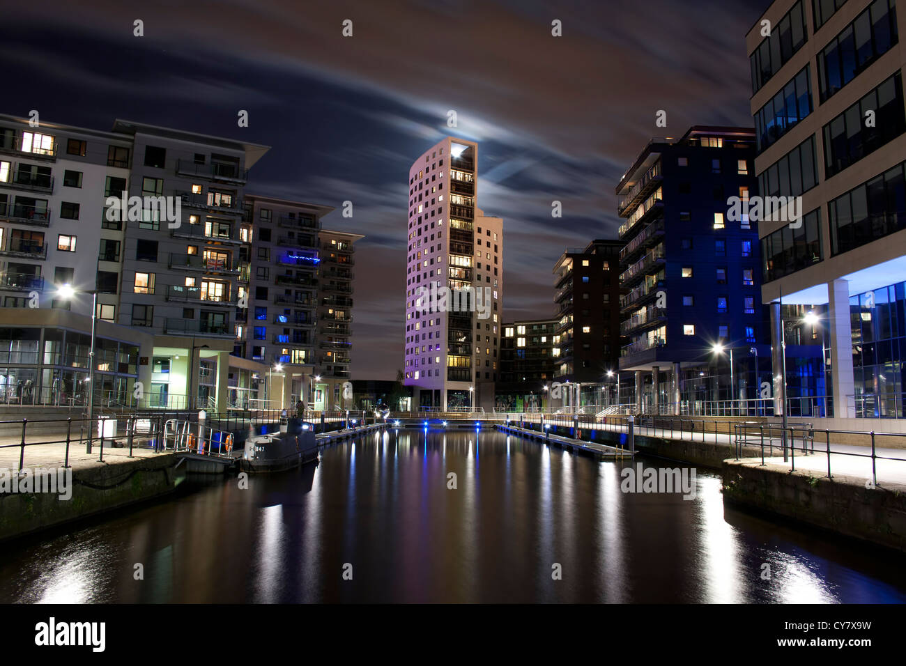Clarence Dock in Leeds,West Yorkshire at night time.With the moon shining through a tower. - Stock Image