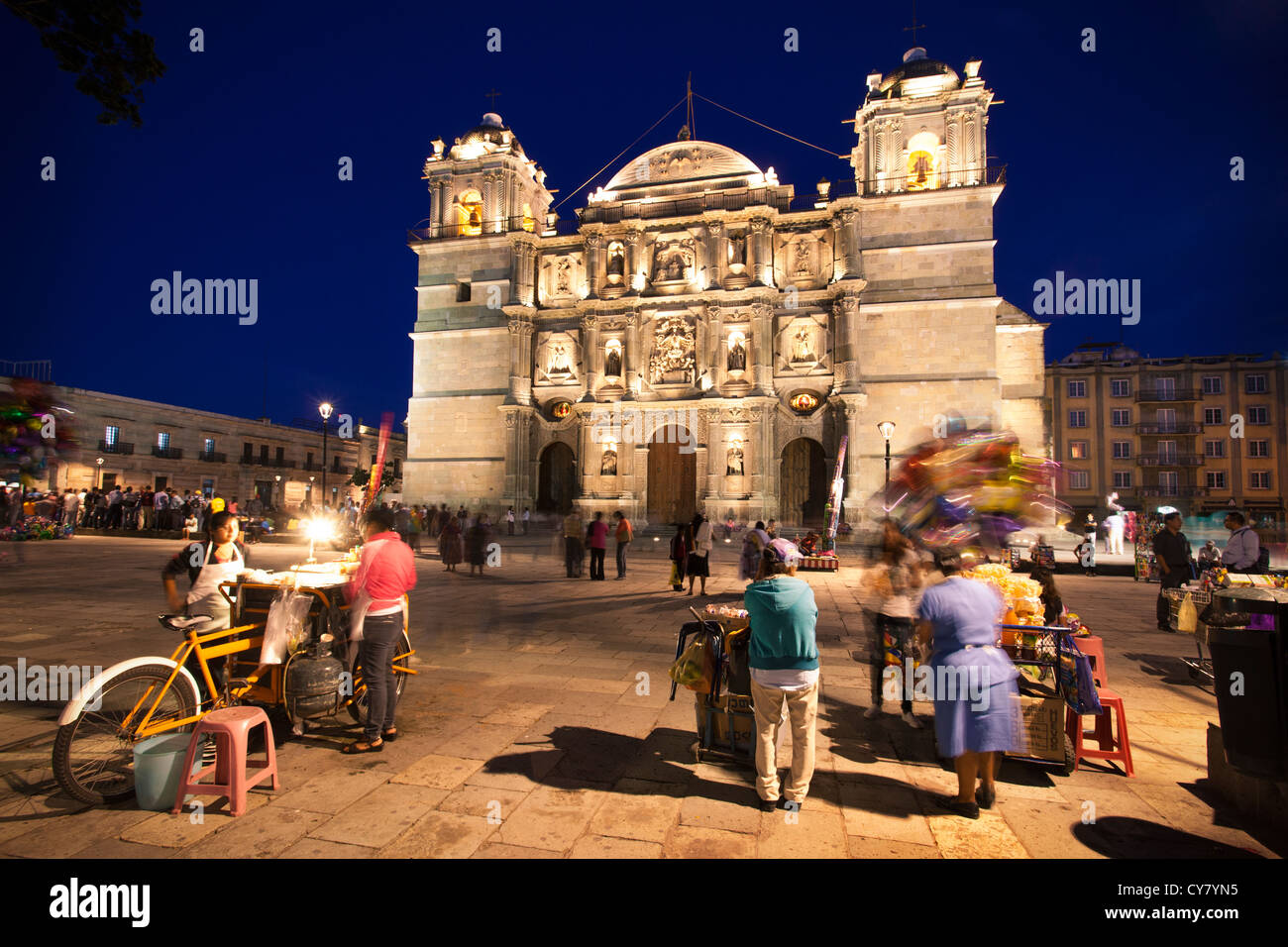 Vendors in front of the cathedral in Oaxaca, Mexico. - Stock Image