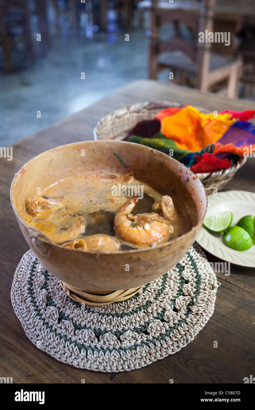 A bowl of 'stone soup', a seafood broth which uses rocks to cook the ingredients, in Santa Maria de Tule, - Stock Image