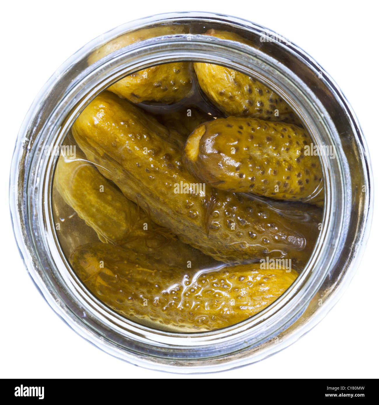 top view on pickled cucumbers in glass jar isolated on white background - Stock Image