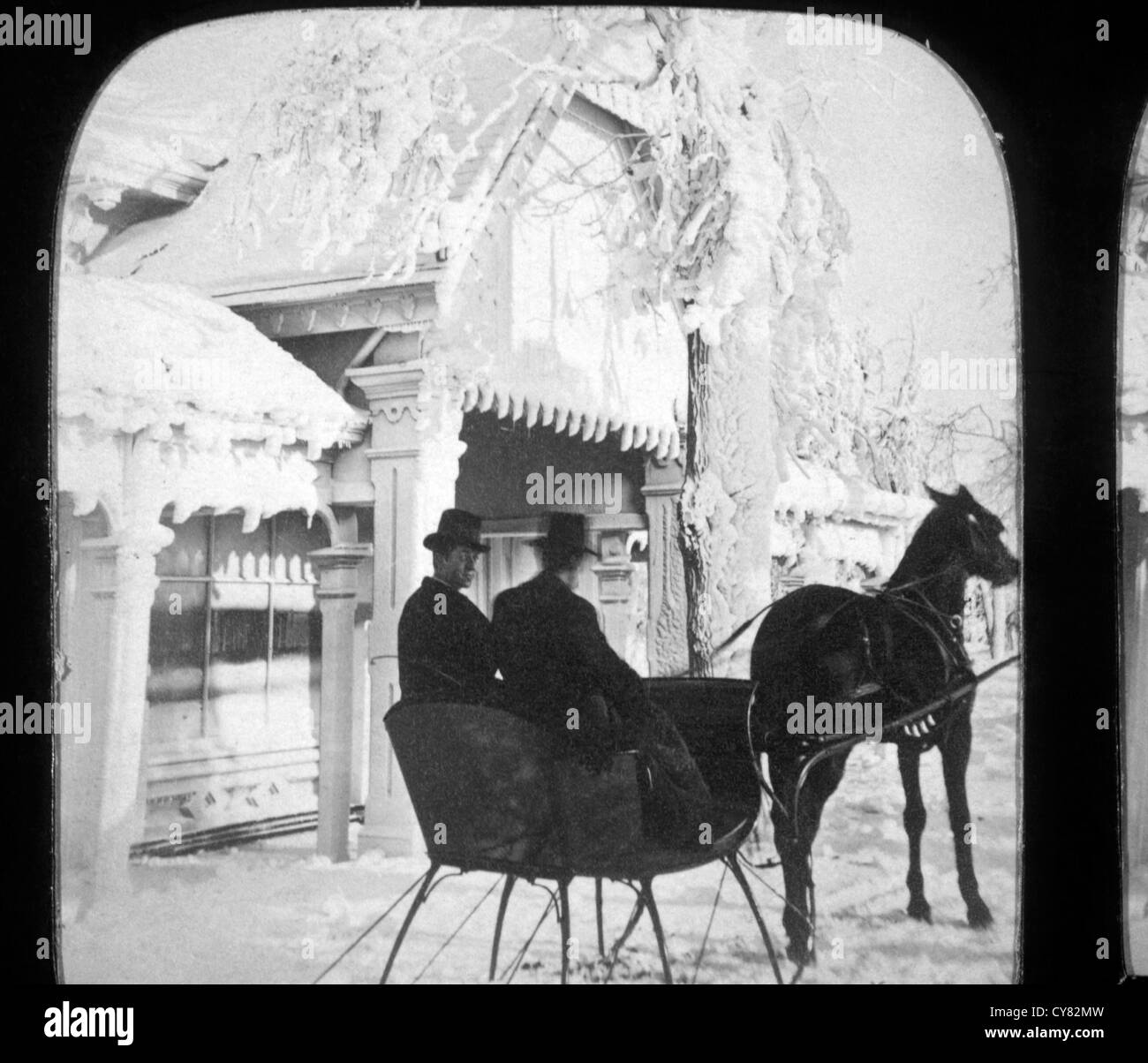 Two People Riding in Horse-Drawn Sleigh, Stereo Photograph, Circa 1900 Stock Photo