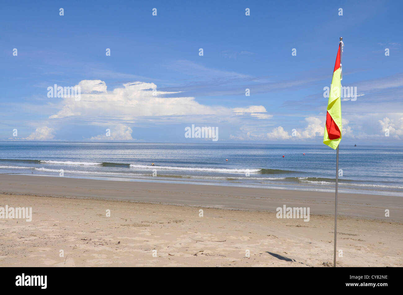 Red and Yellow flag on beach in Sabah, Borneo, Malaysia - Stock Image