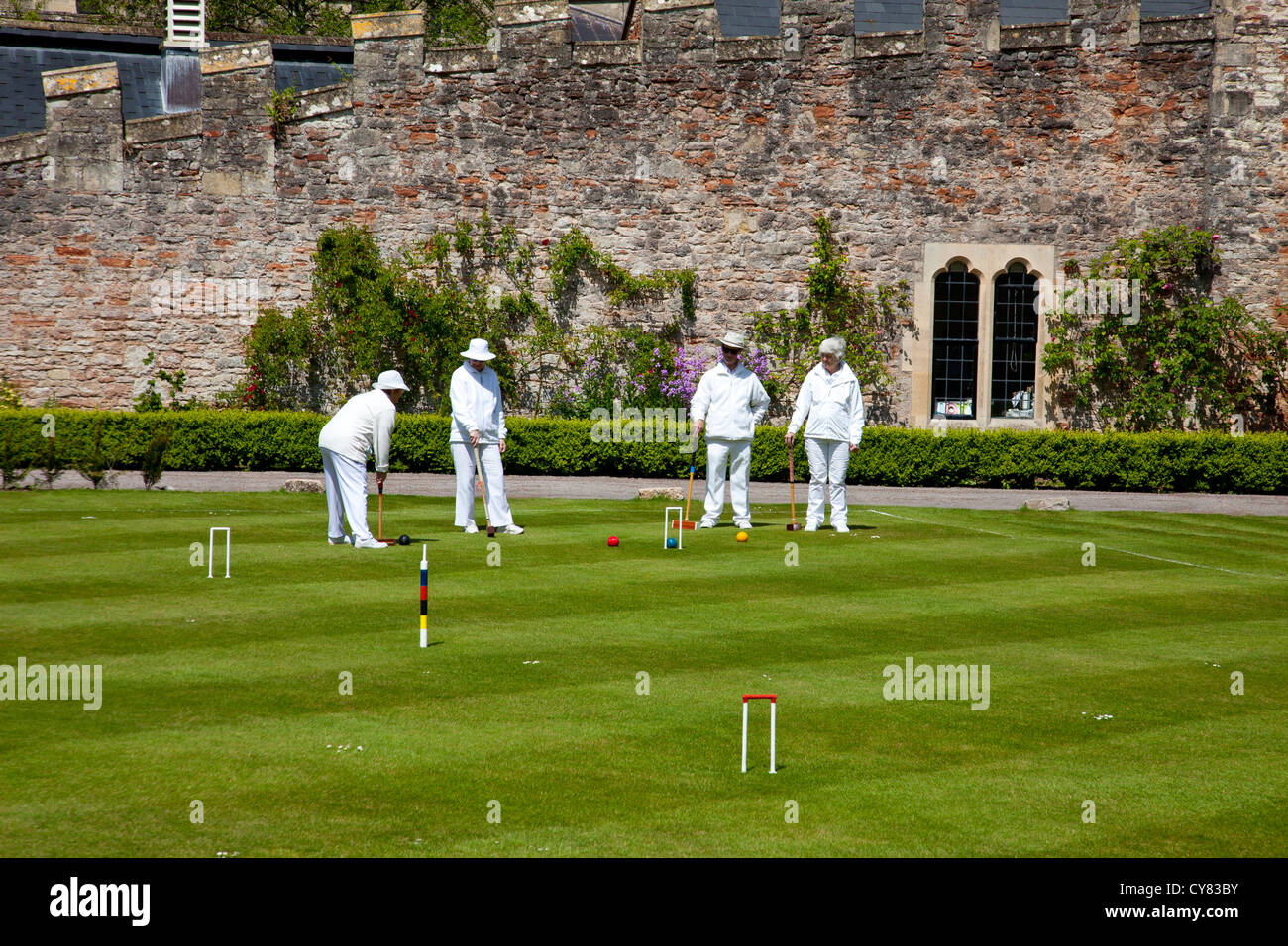 Croquet on the lawn inside the Bishop's Palace grounds at Wells, Somerset, England, UK - Stock Image
