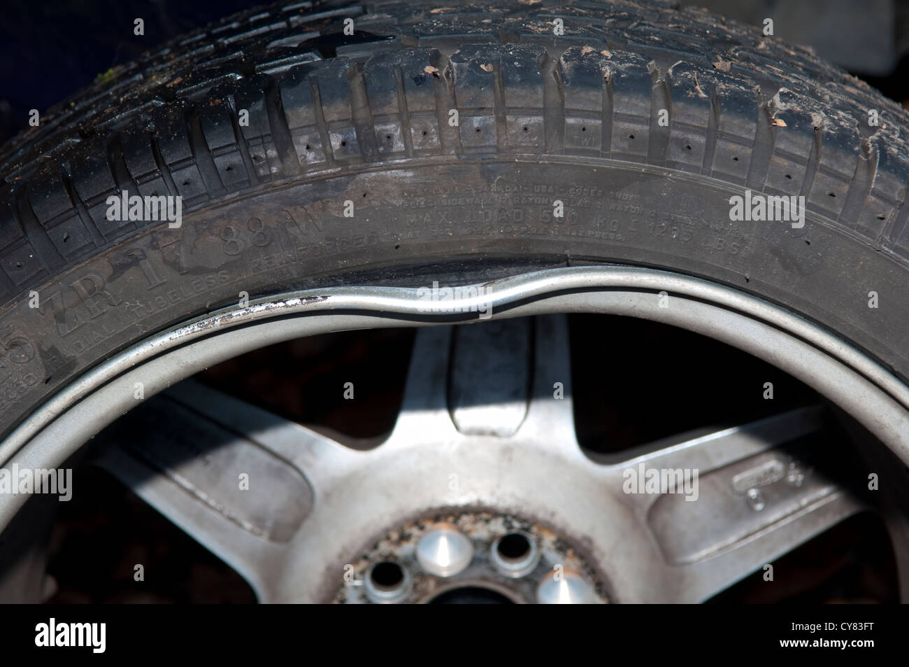 Wheel rim damage caused by a pothole Stock Photo: 51194860 ...
