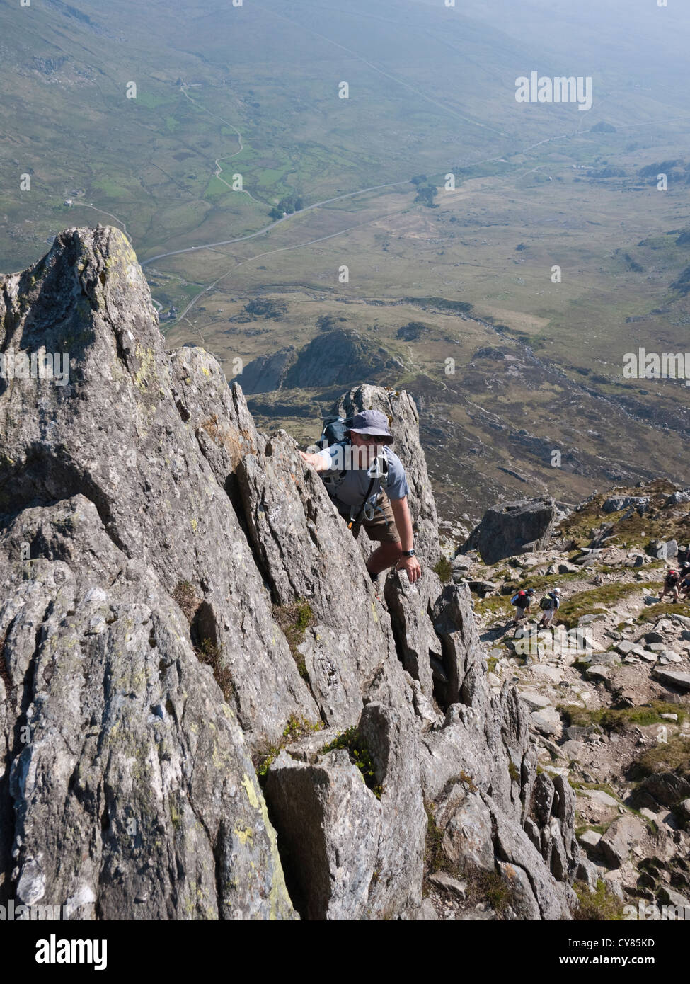 A scrambler on the north ridge of Tryfan, a popular grade 1 scramble on one of Snowdonia's finest peaks. - Stock Image