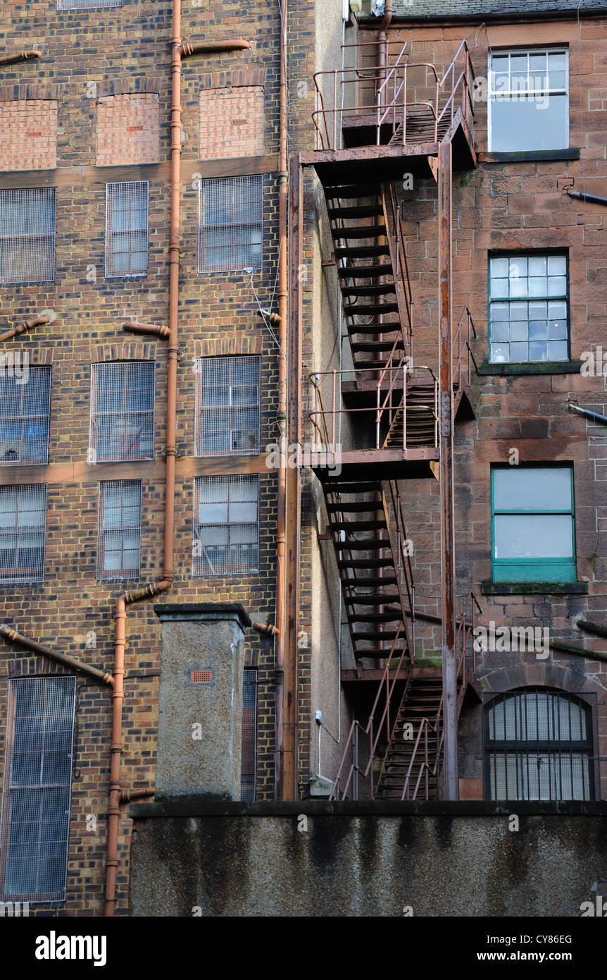 External steel fire escape stairs on a building in Govan, Glasgow, Scotland, UK - Stock Image