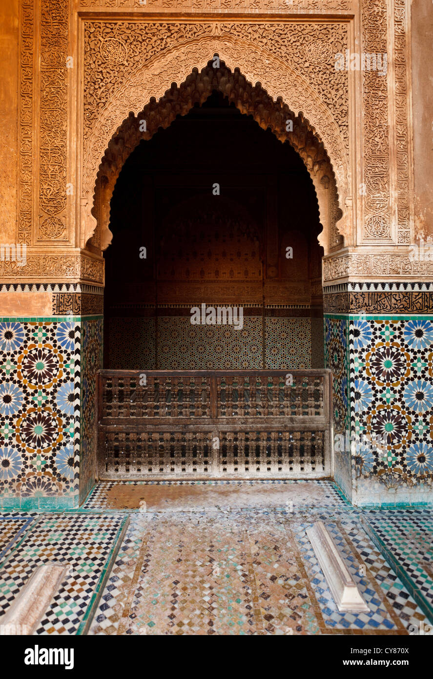 Detail of an ornate turquoise and blue mosaic tile and stone alcove inside the courtyard of a mosque in Marrakesh, Stock Photo