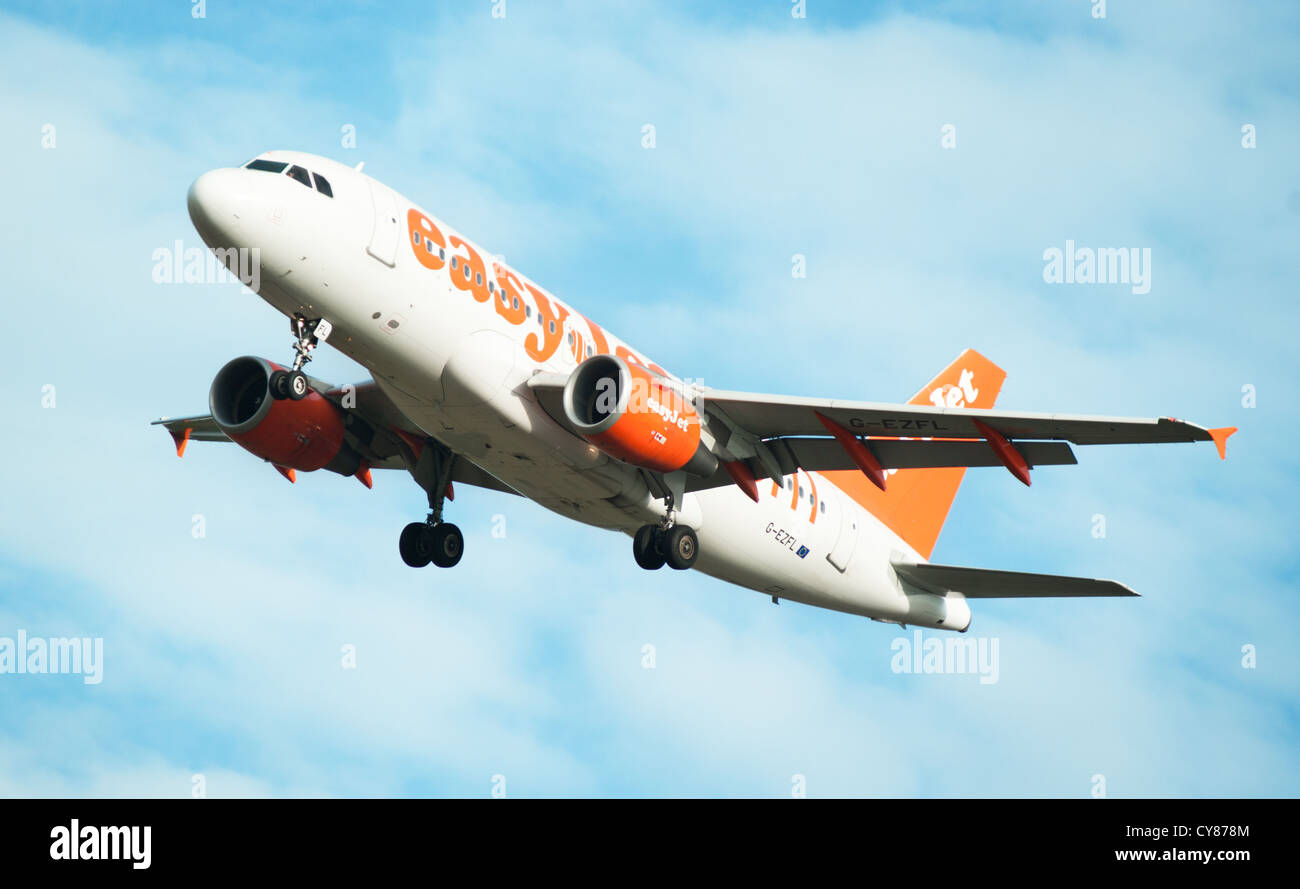 Easyjet airplane flying in the air - Stock Image