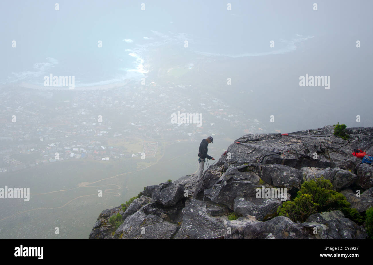 Climber at Table mountain, Cape town in the background, South Africa. - Stock Image