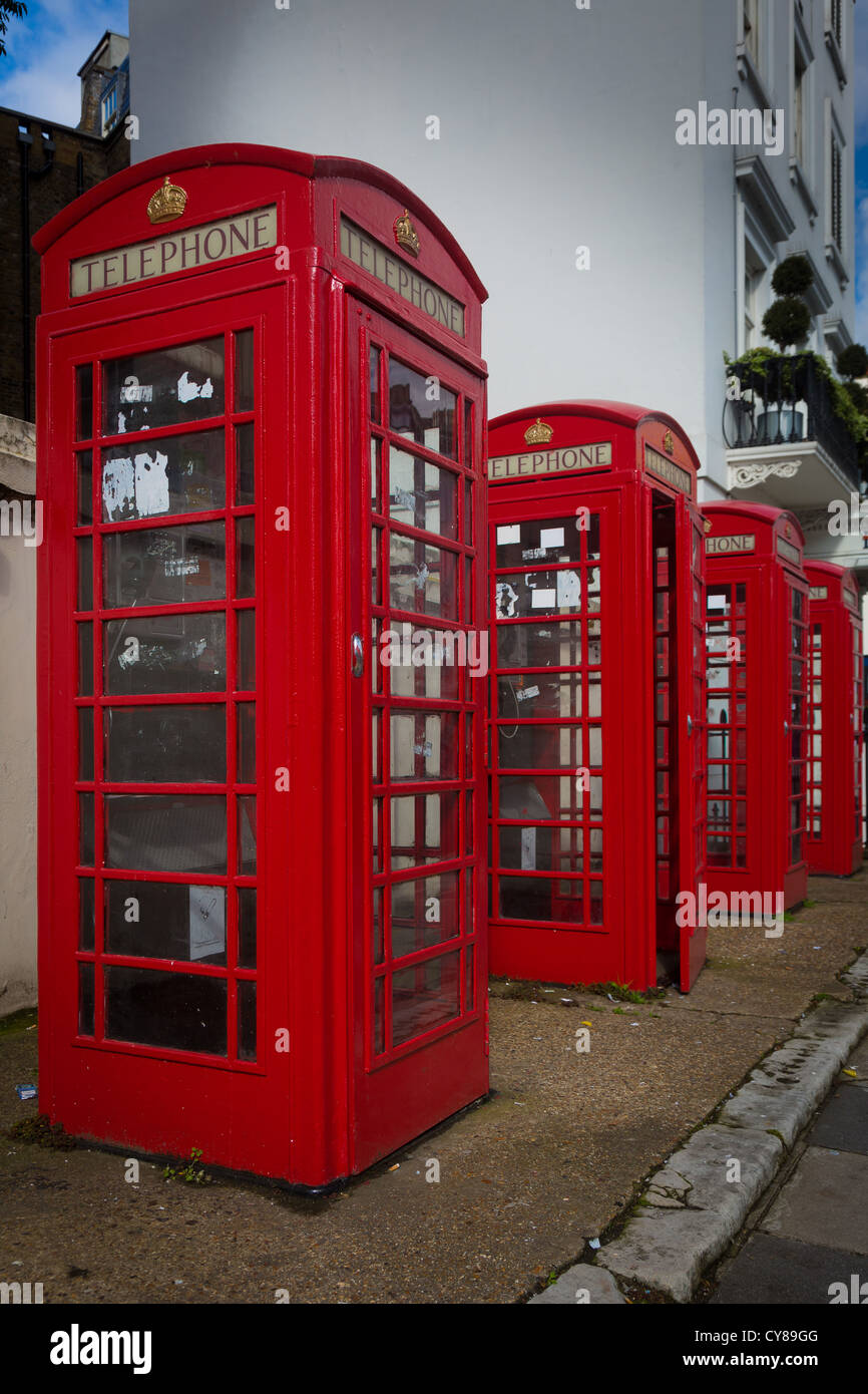 Typical red phone booths in the city of London - Stock Image