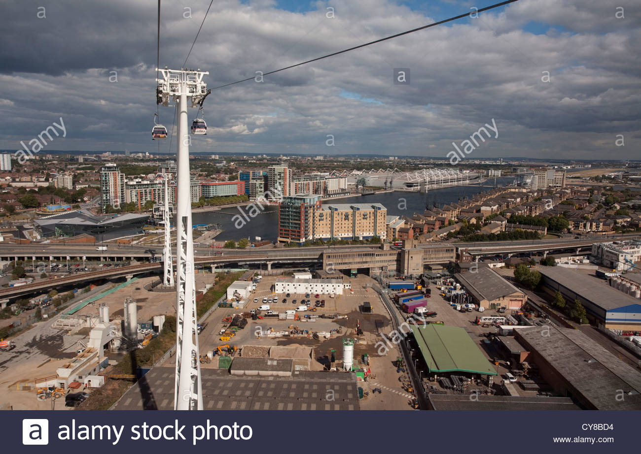 Looking towards the Royal Victoria Dock, London, from the Emirates Air Line cable car across the River Thames - Stock Image