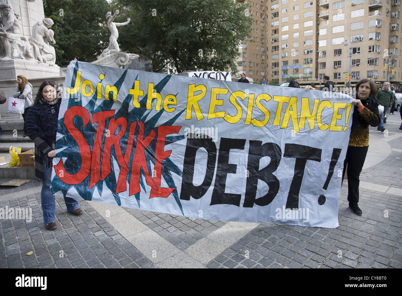 'Occupy Dept' an arm of Occupy Wall Street speak out against student debt at Columbus Circle, NYC. - Stock Image